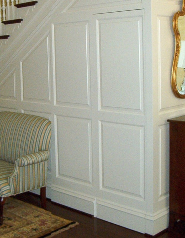 hidden compartment behind wainscott paneled wall