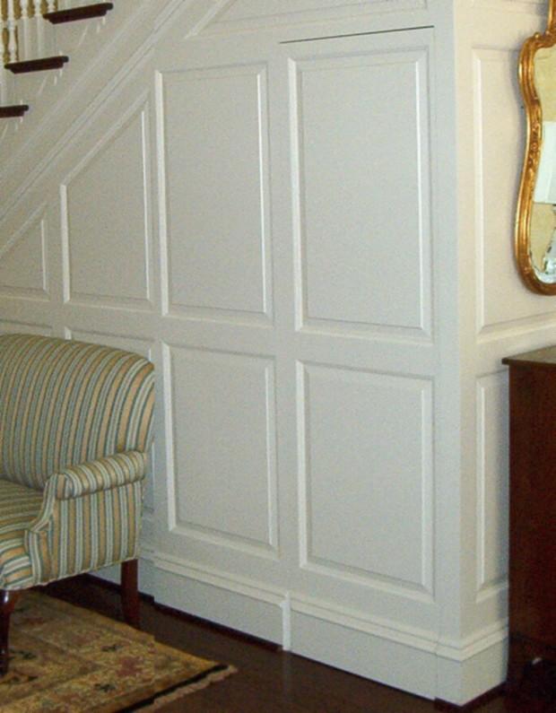 hidden compartment behind wainscott paneled wall